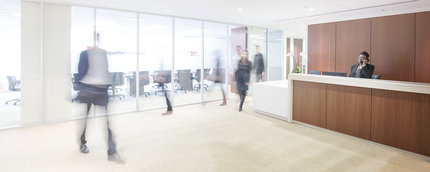 People moving through Marquette Associates' offices by Blue Flame Thinking.
