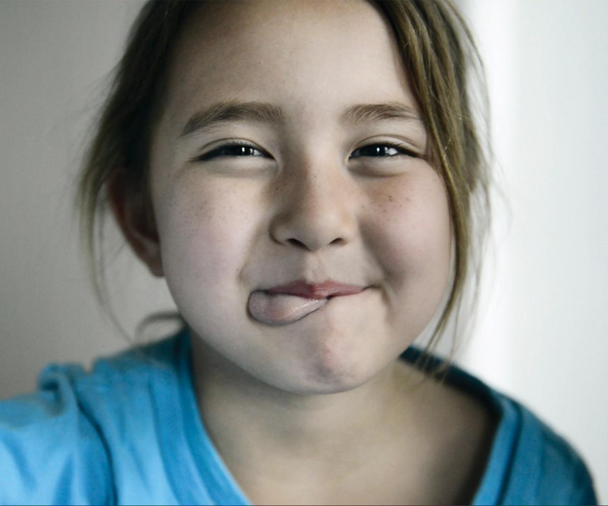 Young girl making a silly face from Gilda's Club Chicago's awareness campaign created by Blue Flame Thinking.